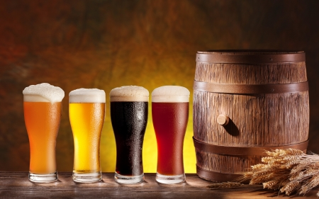 Beer glasses with a wooden barrel. Background - dark yellow gradient.