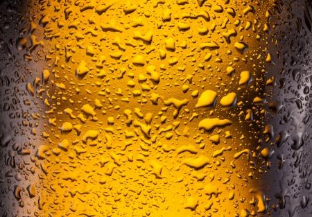 dewed: close  shot of drops on a bottle beer.