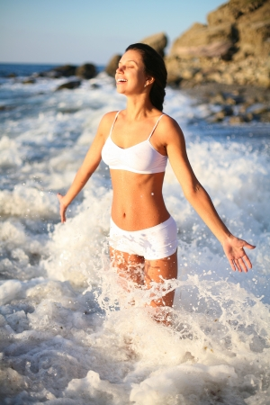inner strength: Happy beautiful girl in the sea waves