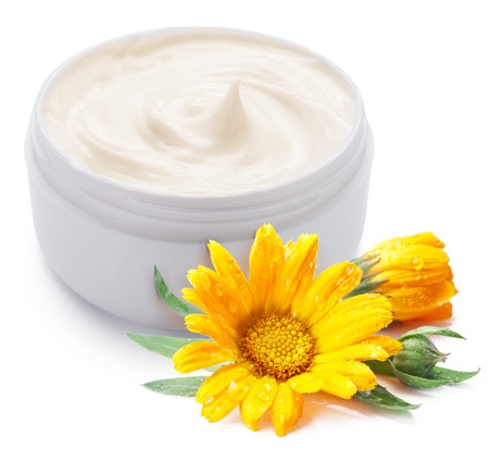 cosmetic cream: Jar of cream and calendula flower on a white background. Stock Photo