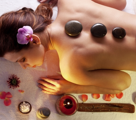 Woman getting stones spa procedures   photo