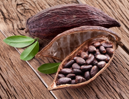 pod: Cocoa pod on a dark wooden table