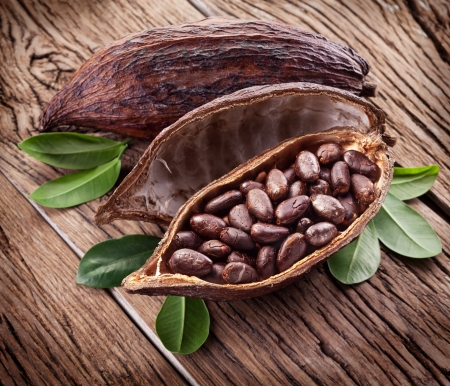 cocoa bean: Cocoa pod on a dark wooden table