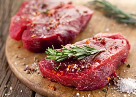 beef meat: Raw beef steak on a dark wooden table.