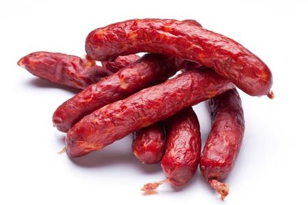 white sausage: Smoked sausages on white background
