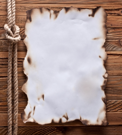 encaustic: Image of old paper on wood background