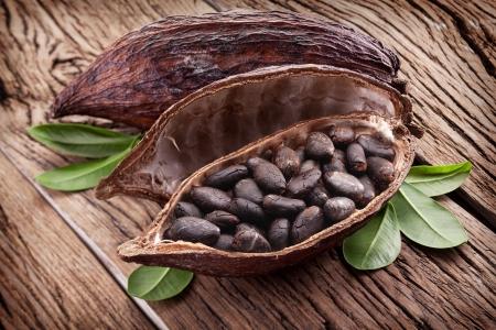 pod: Cocoa pod on a dark wooden table.