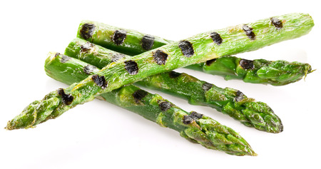 Grilled shoots of asparagus isolated on a white background.
