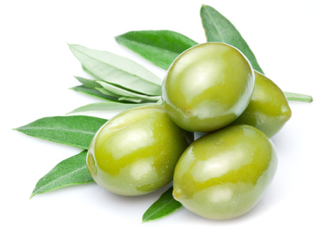 Green olives with leaves isolated on a white. Stock Photo