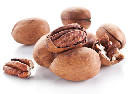 pecan: Pecan nuts isolated on a white background.