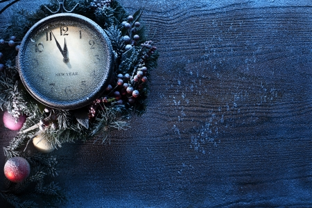 merry time: Christmas clock over snow wooden background. Five to twelve.