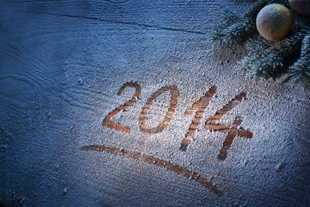 New Year 2014 on snow-covered wooden desk. Stock Photo - 23321365