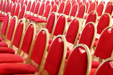 Ranges of empty red chairs. Closeup shot photo