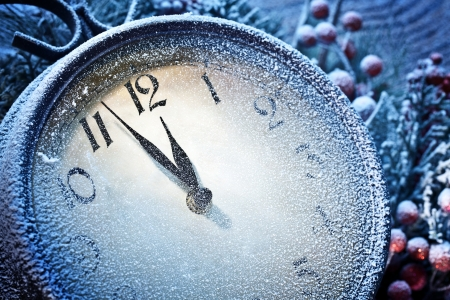 merry time:  New Year clock powdered with snow. Five to twelve.