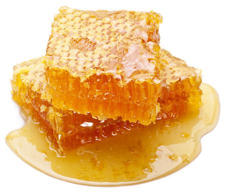 Honingraat op een witte achtergrond. Stockfoto
