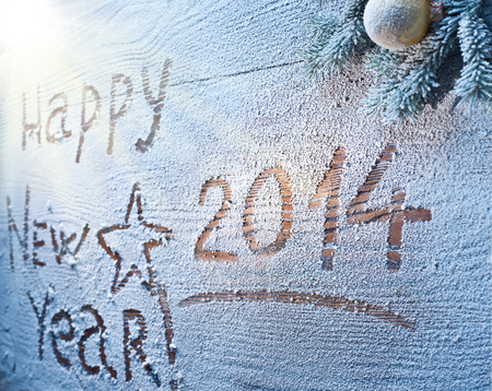 snowcovered: New Year 2014 on snow-covered wooden desk  Stock Photo
