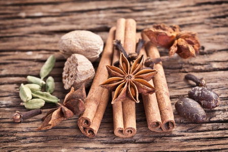 anisetree: Spices on a old wooden table. Stock Photo