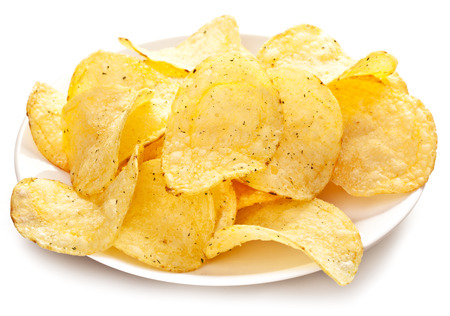 nosh: Potato chips in a plate on a white background. Stock Photo