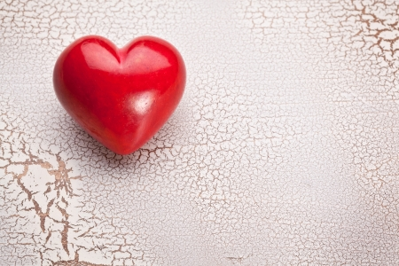craquelure: Valentines Day. Red heart on a white craquelure wooden table. Stock Photo