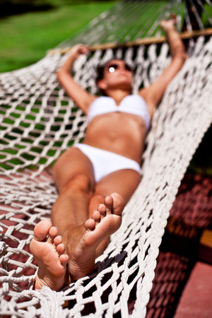 Young woman in hammock. The face in defocus. photo