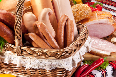 processed: Variety of sausage products in basket. Close-up shot.
