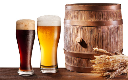 woden: The glasses of beer near woden barrel. File contains clipping pathes.