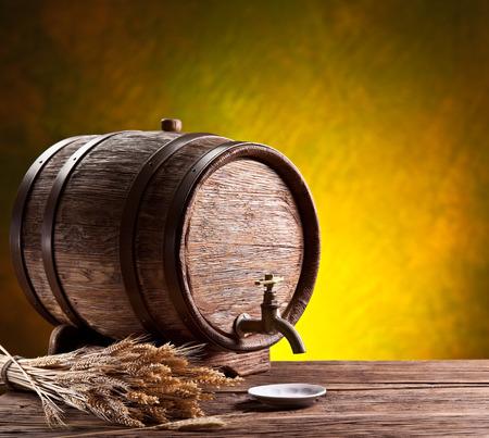 oak barrel: Old oak barrel on a wooden table. Behind blurred dark background.