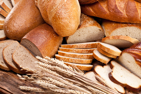 carbohydrates: Different bread and bread slices. Food background. Stock Photo
