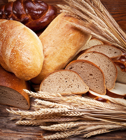 bread basket: Different bread and bread slices. Food background. Stock Photo
