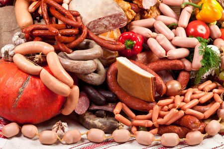 processed: Variety of sausage products and vegetables.Close-up shot.