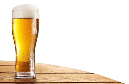 Beer glass on the bar table isolated on a white. Contains clipping paths. photo