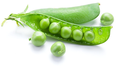 contained: Fresh peas are contained within a pod isolated on a white background.