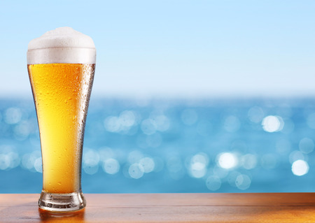 cold beer glass on the bar table