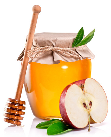 honey apple: Glass can full of honey, apple and wooden stick on white background. Stock Photo