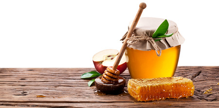apple honey: Glass can full of honey, apples  and on old wooden table. Clipping paths. Stock Photo
