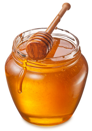 objects with clipping paths: Glass can full of honey and wooden stick in it. Clipping paths.