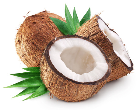 Coconuts and its half with leaves. File contains clipping paths.