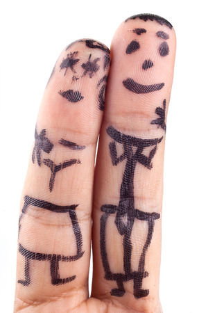 smileys: Smileys painted on mans fingers.