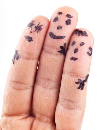 smileys: Smileys of family painted on mans fingers.