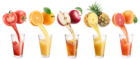 Fresh juice pours from fruits and vegetables in a glass. Clipping path. On a white background.