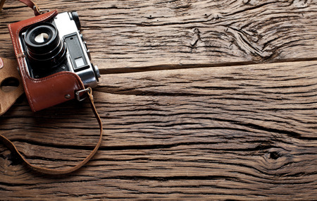 rangefinder: Old rangefinder camera on the old wooden table. Stock Photo
