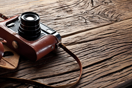 front desk: Old rangefinder camera on the old wooden table. Stock Photo