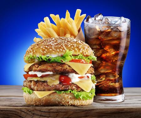 hamburger steak: Hamburger, potato fries, cola drink. Takeaway food.