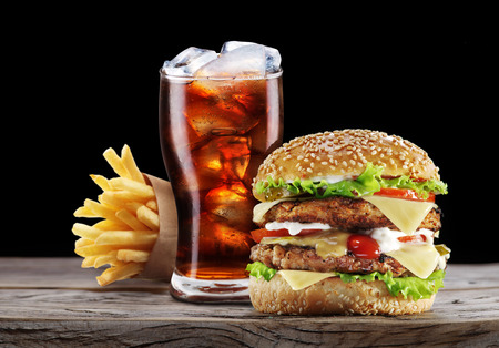 drink: Hamburger, potato fries, cola drink. Takeaway food.