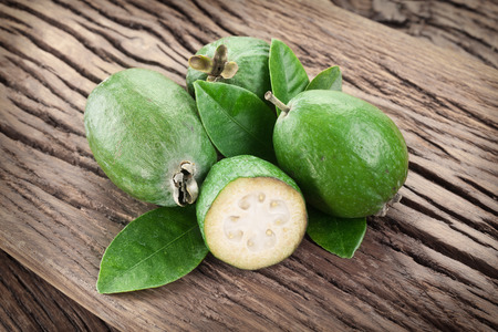 feijoa: Feijoa fruits on old wooden table.