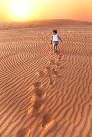 desert footprint: Baby - girl running in the desert.