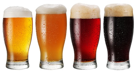 Glasses of beer on white background.