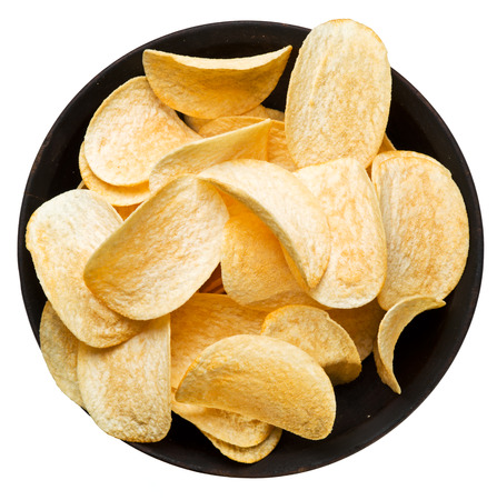 Potato chips in the bowl. File contains clipping paths. Фото со стока