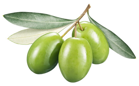 Green olives with leaves on a white Stock Photo