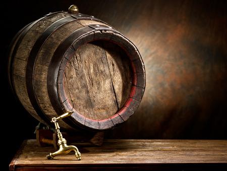 oak barrel: Old oak wine barrel on wooden table. Stock Photo
